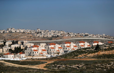 A view shows the Israeli settlement of Pisgat Zeev in the foreground as the Palestinian town of Al-Ram is seen in the background in the Israeli-occupied West Bank