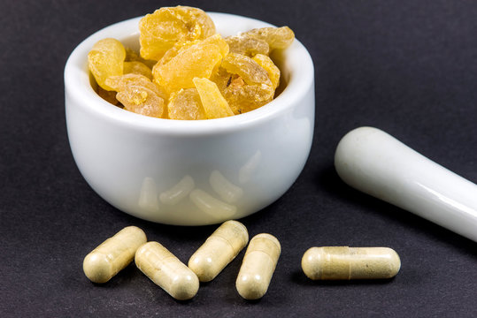Olibanum, pieces in a mortar with olibanum capsules