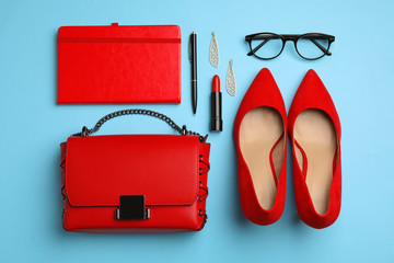 Wall Mural - Flat lay composition with stylish woman's bag and accessories on light blue background