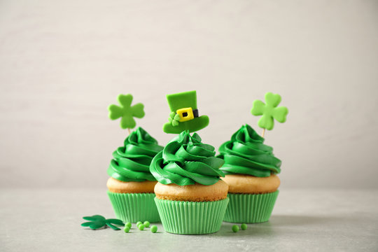 Delicious decorated cupcakes on light table. St. Patrick's Day celebration