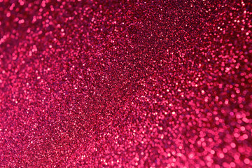 Hot pink shine glitter background. Selective focus. Beautiful sparkle abstraction. Glamour Bokeh...