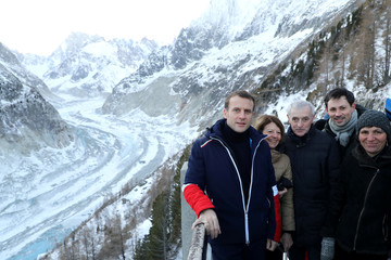 French President Emmanuel Macron and scientists pose for a picture as they look at the Mer de Glace glacier, near Chamonix, at the Mont Blanc mountain range in the French Alps