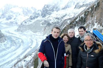 French President Emmanuel Macron, scientists Jean Jouzel and Minister for the Ecological and Inclusive Transition Elisabeth Borne pose for a picture as they look at the Mer de glace glacier from the Montenvers railway station near Chamonix