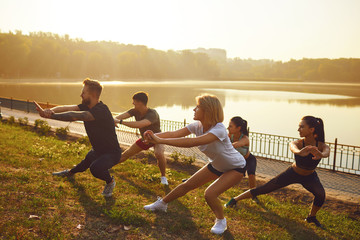 Group of young people at a training session in a park
