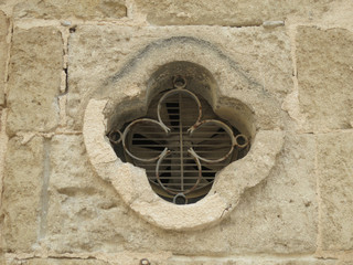 clove shaped ventilation hole in a sandstone wall
