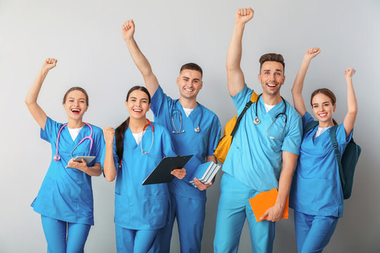 Group of happy medical students on light background