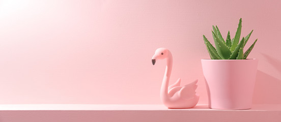 Foto op Plexiglas Flamingo small green cactus plant and flamingo bird