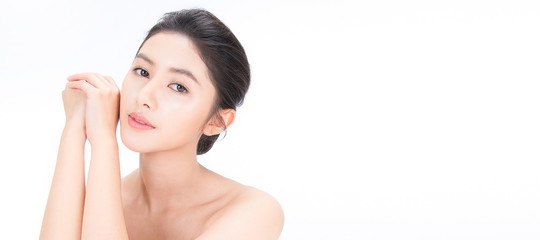 Closeup portrait of beauty asian woman fair perfect healthy glow skin hand touch shoulder copy space, young beautiful asia girl with pretty smile on face. Beauty korean clinic skincare concept banner Fotomurales