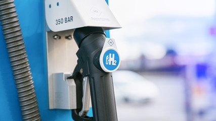 Aachen / Germany - January 31 2020: hydrogen logo on gas stations fuel dispenser. h2 combustion engine for emission free eco friendly transport.