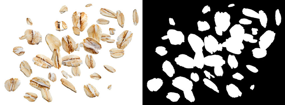 Falling oat flakes isolated on white background with alpha channel