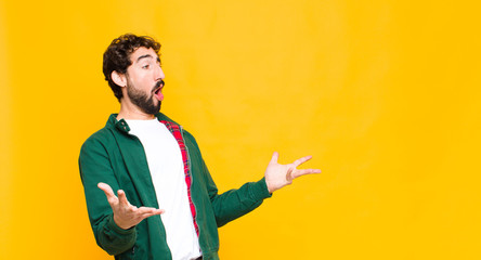 young crazy bearded man performing opera or singing at a concert or show, feeling romantic, artistic and passionate against flat wall