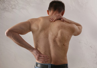 Back Pain Emotional causes. Male body anatomy aesthetic