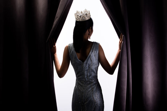 Miss Pageant Beauty Contest wears sequin Evening Gown long dress with sparkle Diamond Crown, Asian Woman opens purple Curtain after win Final round as new way life, opportunity, change everything