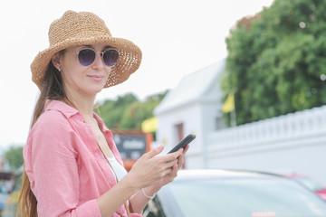 Beautiful women use smartphone app navigator travel in Bangkok city on street