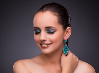 Wall Mural - Beautiful woman with jewellery in beauty concept