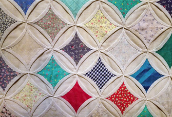 close up of cathedral window quilt pattern