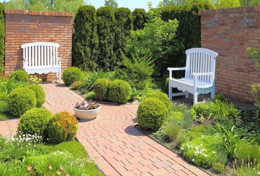 White bench in garden.