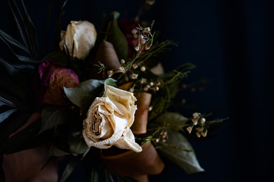 bouquet of vintage dry roses on dark background