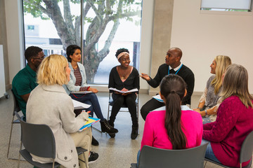 People talking in support group meeting circle
