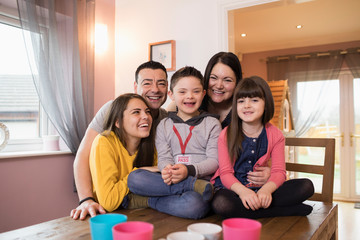 Portrait happy family with Down Syndrome child