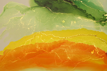 Abstract yellow and green wave blots background. Alcohol ink colors. Marble texture.