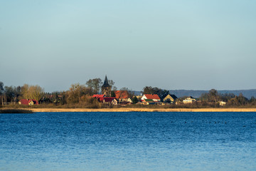 The village Weltyn in Poland seen across the lake