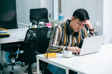 Young office worker looking sleepy stock photo