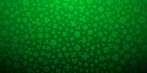 Background on St. Patrick's Day made of clover leaves in green colors Wall mural