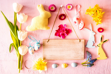 Rustic Wooden Sign With Copy Space. Flat Lay With Spring Flower Blossoms And Easter Decoration Like Easter Bunny. Wooden Pink Background