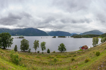 Fototapeten Skandinavien Beautiful Norwegian landscape. view of the fjords with turquoise water. Norway ideal fjord reflection in clear water. Panoramic view