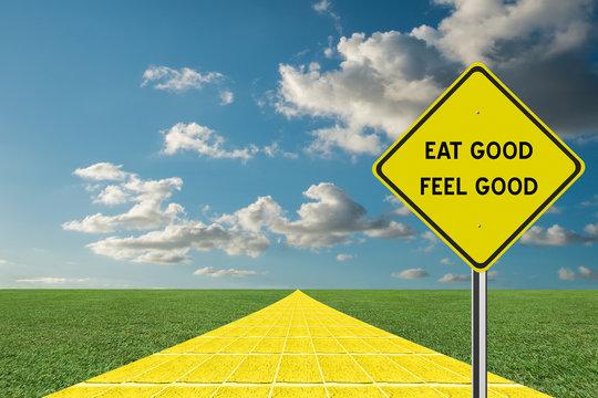 Eat Good Feel Good sign on yellow brick road.