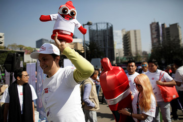 A member of an organization holds a condom puppet during an event organized by AIDS Healthcare Foundation for the International Condom Day, in Mexico City
