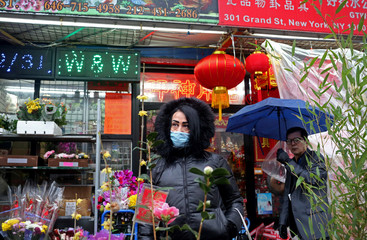 A woman who prefers to remain anonymous poses for a picture in Chinatown in New York