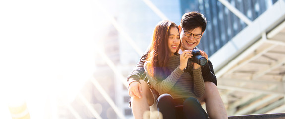 Happy Asian tourist couple in love on vacation concept.