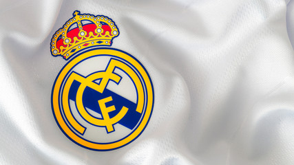 London, UK - February 15 2019:Illustrative editorial of a macro close up of a soccer jersey on the football club Real Madrid logo