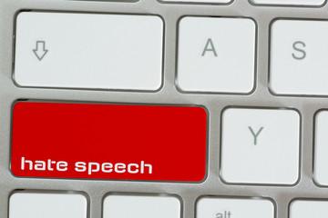 Computer und Taste für Hass Sprache