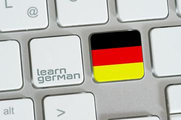 Ein Computer und Taste für Deutsch Lernen