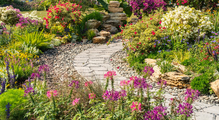 Acrylic Prints Garden path leading through a garden