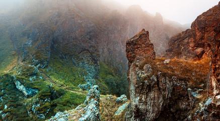 Fotorolgordijn Diepbruine Picturesque multi-colored mountain landscape in fog Elbrus region, wallpaper postcard. Outdoor adventure concept