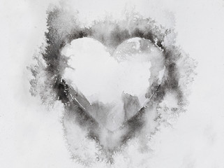 Watercolour splashes heart on white paper background.
