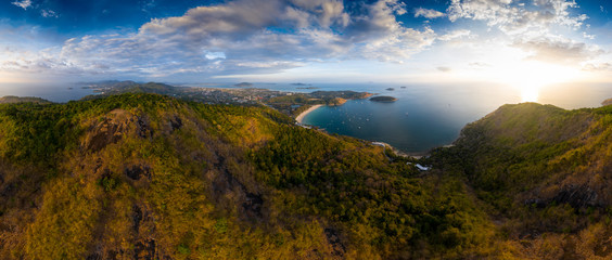 Wall Mural - Aerial panorama of Phuket island in Thailand. Aerial panorama of the southern area of the island of Phuket with Nai Harn beach (in the center) during sunset