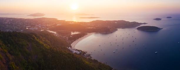 Wall Mural - Aerial panorama of Phuket island and Nai Harn beach at sunrise. Thailand
