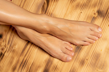 a young woman with a beautifully done pedicure