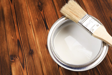 House renovation, paint can on the old wooden background with copy space - Image