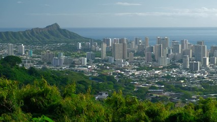 Wall Mural - City of Honolulu as seen from the Tantalus Round Top Drive road in Oahu, Hawaii. Left to right panorama of the city with skyscrapers