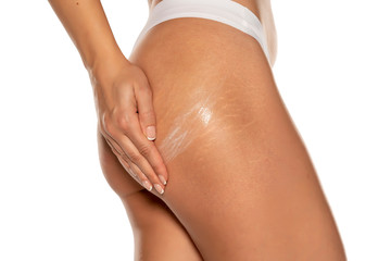 woman applying stretch marks  lotion on her bottom