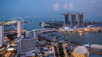 Wall Mural - Time lapse from day to night - Singapore city skyline at sunrise, Marina bay