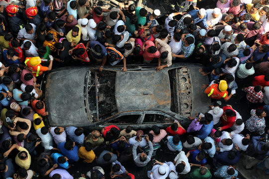 Directly Above Shot Of Damaged Car Surrounded By People