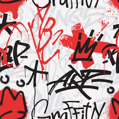 Graffiti seamless pattern in black and red color isolated on white background. Abstract graffiti tags and aerosol spray paint splatter backdrop. Use for poster, t-shirt , textile, wrapping paper.