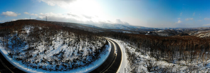 Panoramic 180 degree photo of the road in the mountains between Otaru and Niseko
